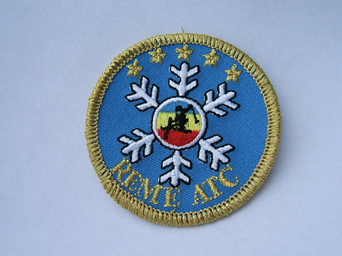 Embroidered badge with a Merrow border.