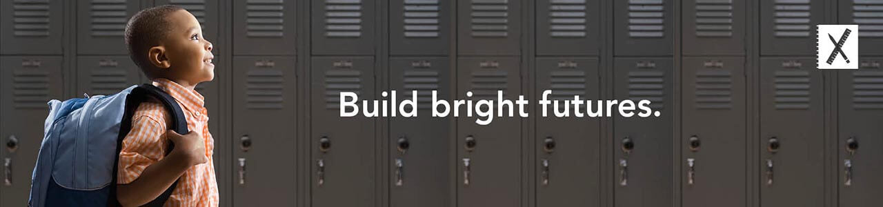Build bright futures. A young boy stands next to a line of lockers, holding the straps of his backpack.
