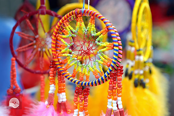 Colorful dreamcatchers hang together after being made