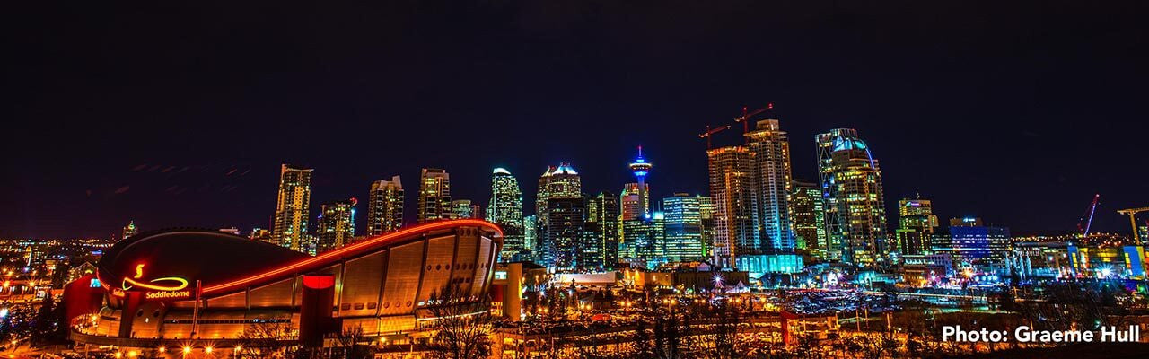 The Calgary skyline glows on a dark night. Photo: Graeme Hull