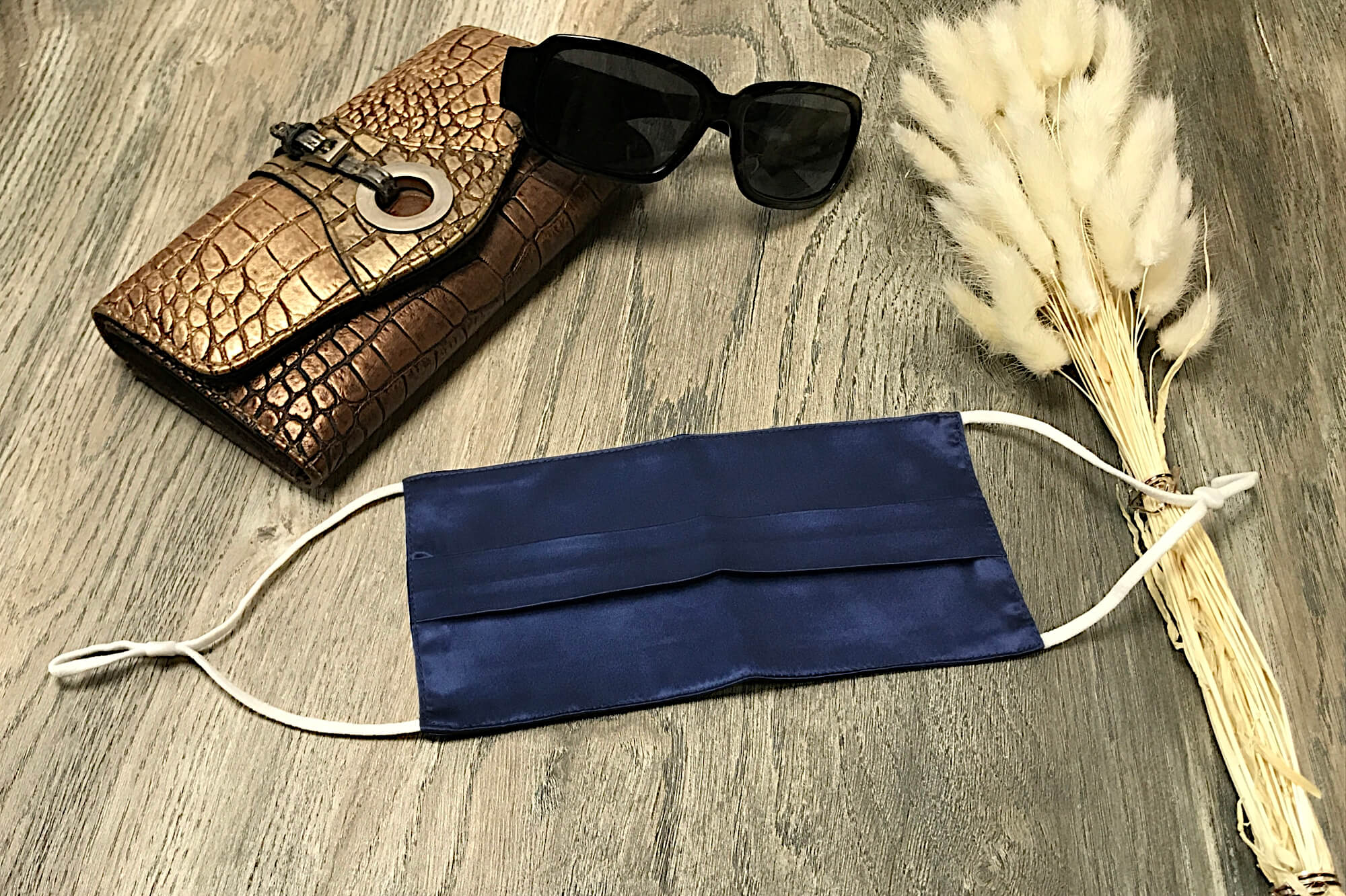 navy blue silk face mask pleated navy silk face covering pure silk face mask 100% mulberry silk face mask lifestyle