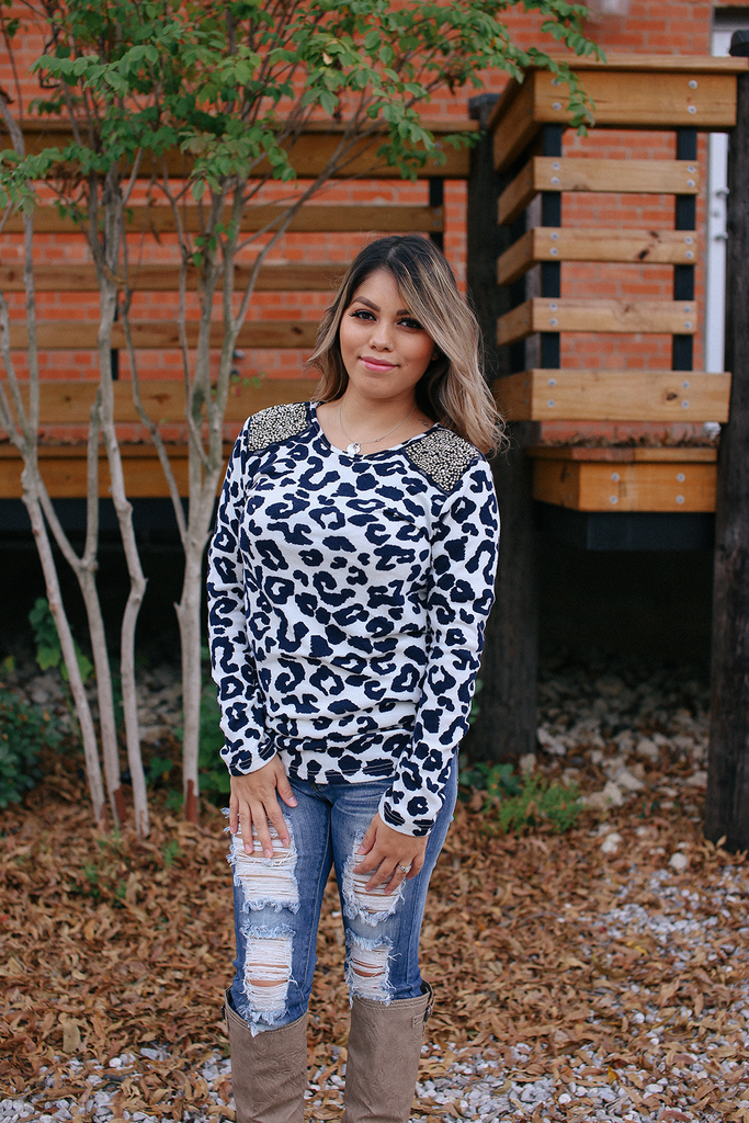black and white leopard print top with jewel detail on shoulders.