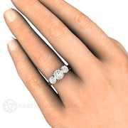 Moissanite Three Stone Engagement Ring on Finger Rare Earth Jewelry