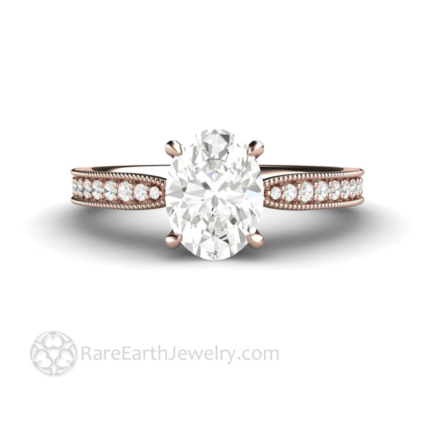 18 Karat Rose Gold Oval Moissanite Solitaire Ring