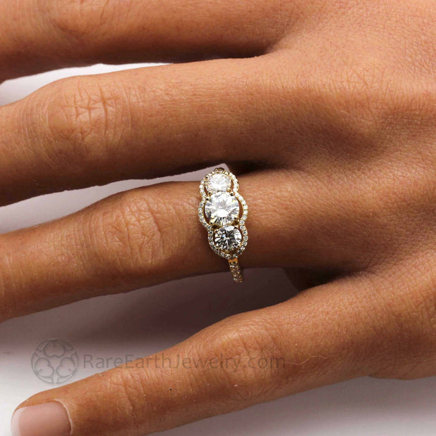 Three Stone Moissanite Engagement Ring with Diamond Halo Design