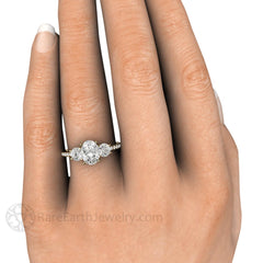 Oval Moissanite 3 Stone Engagement Ring on Finger Rare Earth Jewelry