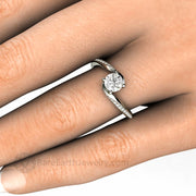 5mm Round Solitaire Bypass Setting with Pave Diamond Accents on the hand by Rare Earth Jewelry