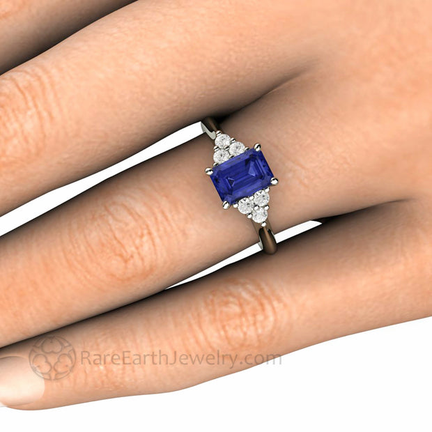 Tanzanite Ring on the Finger Emerald Cut with Diamonds