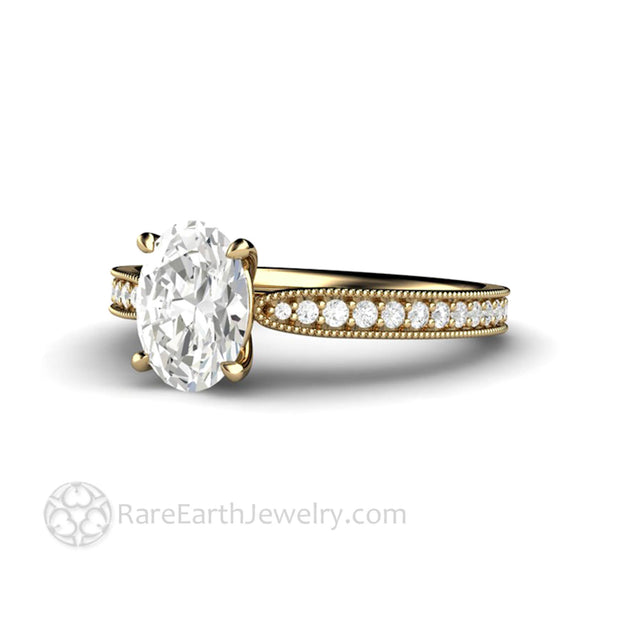 8x6mm Oval Cut Forever One Moissanite Engagement Ring in Yellow Gold with Milgrain