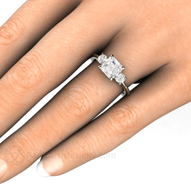 Rare Earth Jewelry Asscher Moissanite Engagement Ring on Finger White Gold 3 Stone Setting