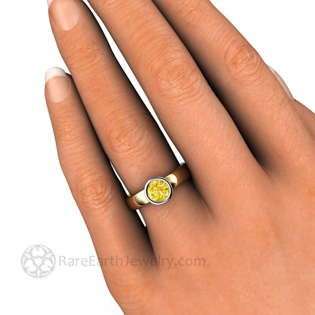 Round Yellow Sapphire Halo Bezel Ring on Finger - Rare Earth Jewelry