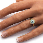 Blue Moissanite Ring on the Hand Photo in Yellow Gold Vintage Inspired Engagement Ring Setting