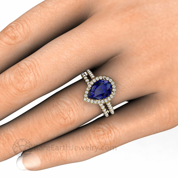Blue Sapphire Pear Halo Bridal Set Pave Diamonds on the hand