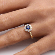 Natural Blue Sapphire Floral Cluster Engagement Ring on the Hand custom made by Rare Earth Jewelry