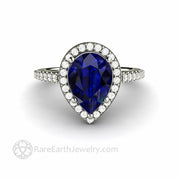 Blue Sapphire and Diamond Ring in White Gold Pear Halo Design September Birthstone