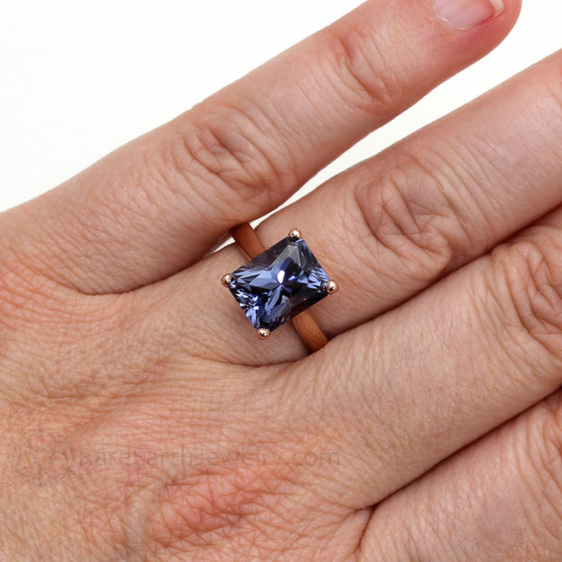 Color Change Sapphire Ring on the Hand Emerald Cut Four Prong Solitaire on the Finger Sapphire Ring in 14K Rose Gold Hand Shot