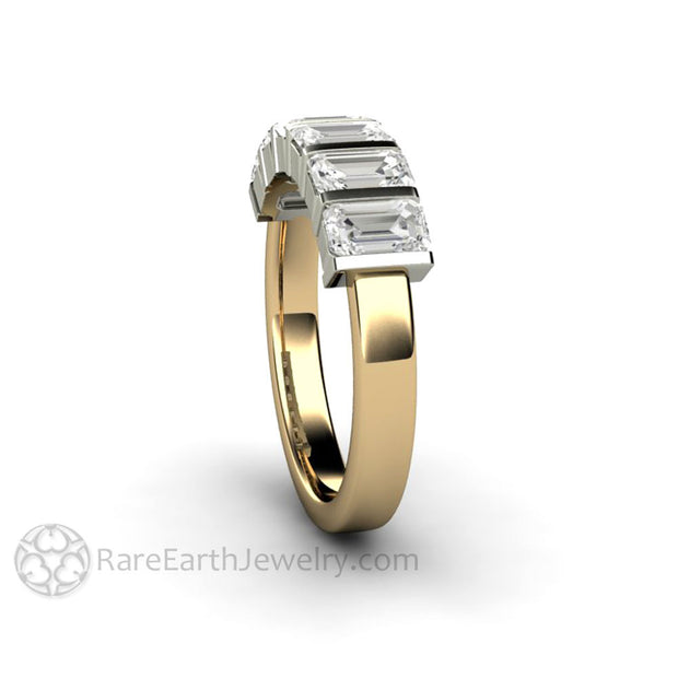 Side view of emerald cut moissanite anniversary band