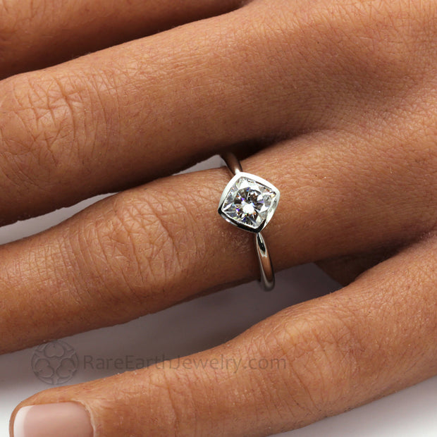 Cushion Cut Moissanite Engagement Ring Bezel Set Solitaire on the Hand
