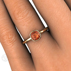 Rare Earth Jewelry Sapphire Cushion Solitaire Ring on Finger Orange Gemstone