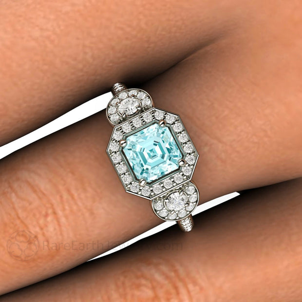 Asscher Aquamarine 3 Stone Halo Ring on Finger Rare Earth Jewelry