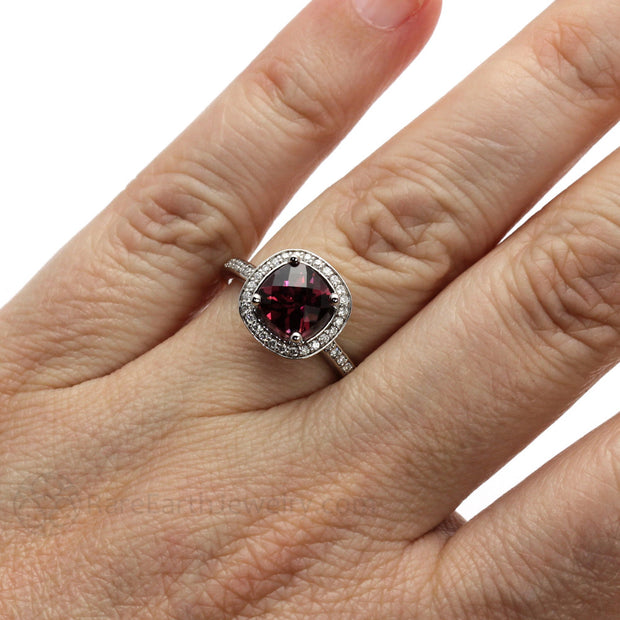Rare Earth Jewelry Garnet Ring on Finger Cushion Cut with Diamond Halo and Accent Stones