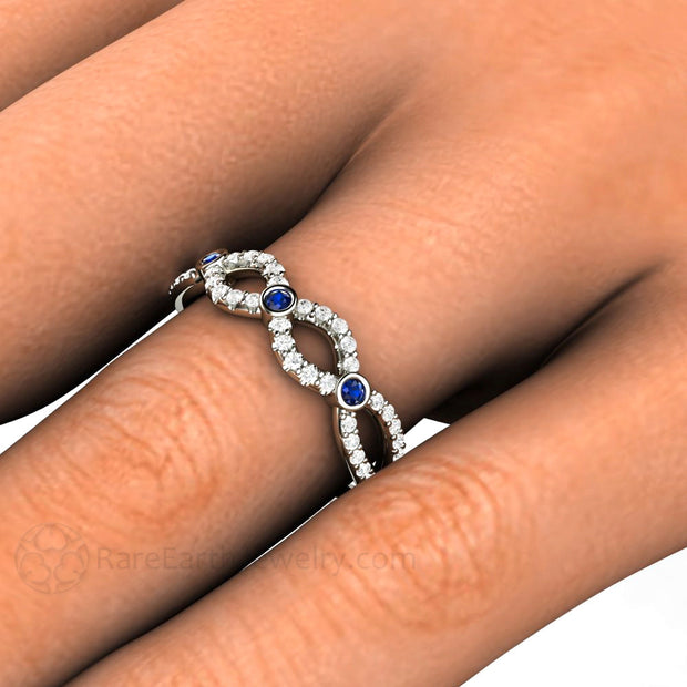 Blue Sapphire Infinity Ring on Finger Rare Earth Jewelry
