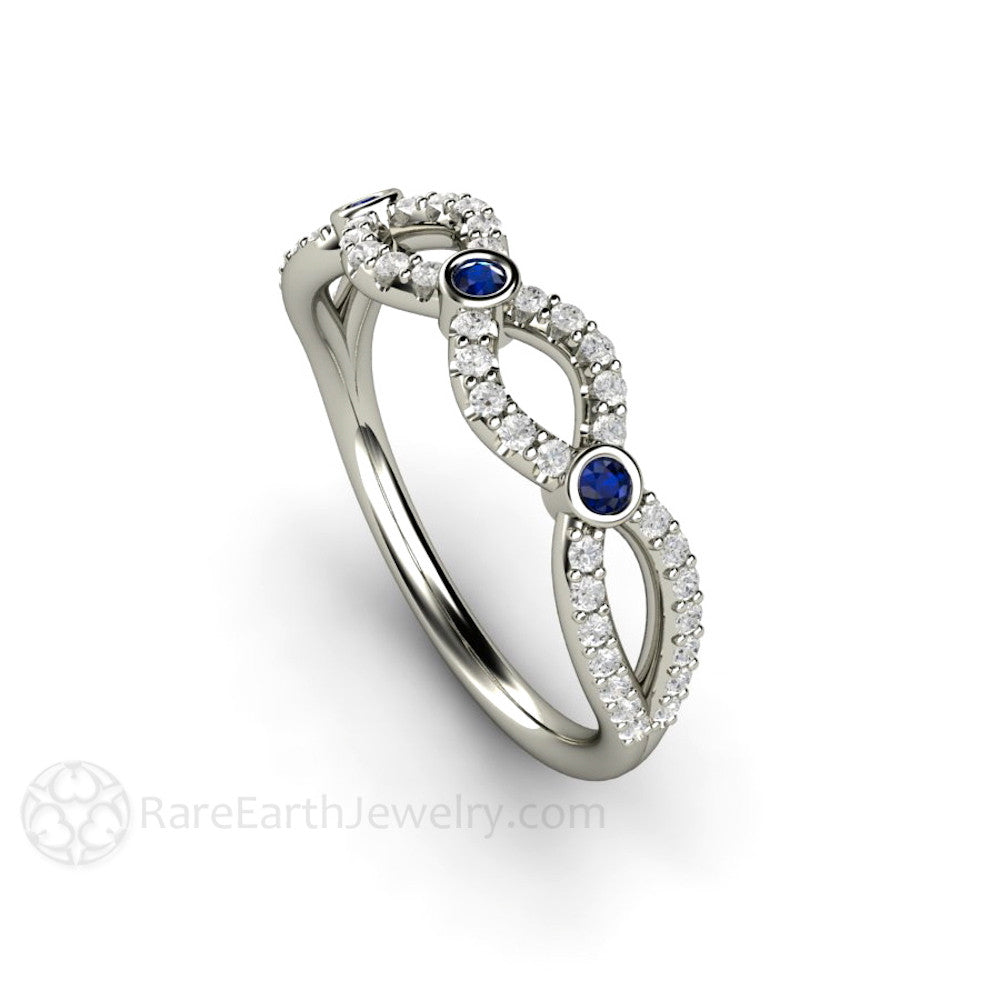 diamond and blue sapphire infinity wedding ring or band