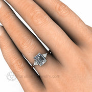Emerald Cut 3 Stone Grey Moissanite Engagement Ring Hand Photo