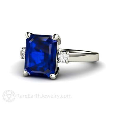 Rare Earth Jewelry Emerald Cut Blue Sapphire Ring 3 Stone Engagement