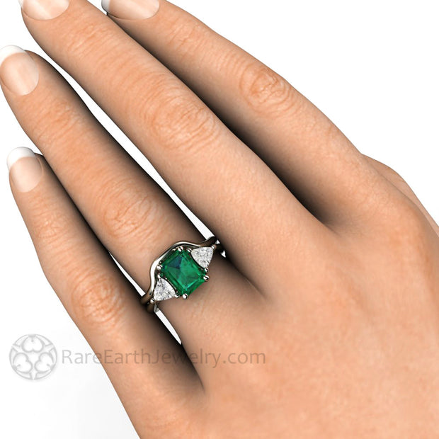 Green Emerald Bridal Set on Finger Emerald Cut with Sapphire Trillion Side Stones by Rare Earth Jewelry