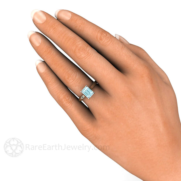 Rare Earth Jewelry Aquamarine Solitaire Ring on Finger
