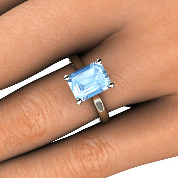 Emerald Cut Aquamarine Ring on Finger Rare Earth Jewelry