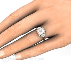 Emerald Cut 3 Stone Morganite Engagement Ring on Finger Rare Earth Jewelry