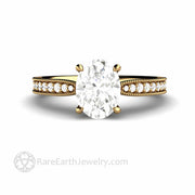Four Prong Oval Charles and Colvard Moissanite Solitaire Ring in 18K Yellow Gold