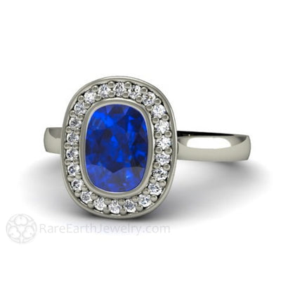 Cushion Blue Sapphire Engagement Ring Bezel Set Diamond Halo