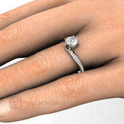 Lab Created Diamond Solitaire Engagement Ring on the Finger handmade by Rare Earth Jewelry