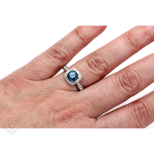 London Blue Topaz and Diamond Ring On the Hand Diamond Halo Engagement Ring on the Finger by Rare Earth Jewelry