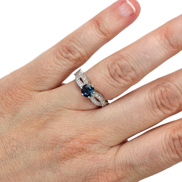 Rare Earth Jewelry Infinity Blue Topaz Engagement Ring on Finger
