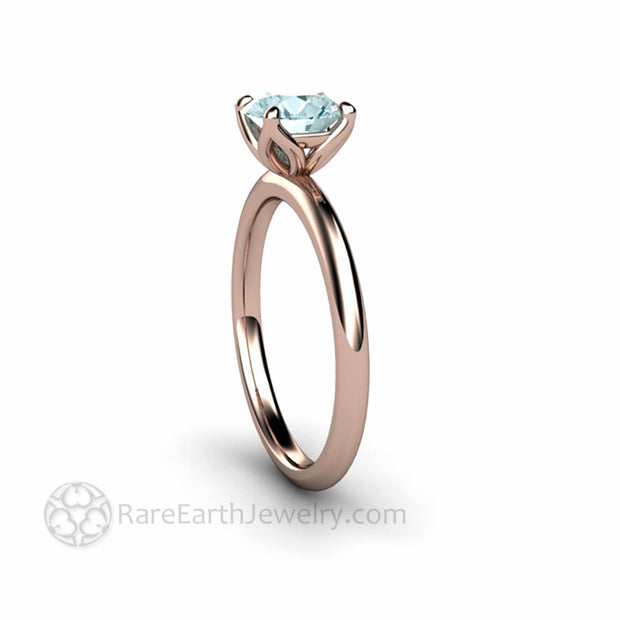 Lotus Flower Engagement Ring in Aquamarine and Rose Gold Rare Earth Jewelry
