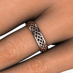 Rose Gold Wedding Band on Finger Woven Pattern Rare Earth Jewelry