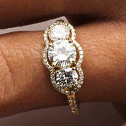 3 stone moissanite ring in vintage style yellow gold setting
