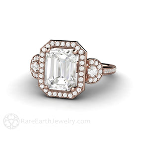 Moissanite and rose gold ring emerald cut halo 3 stone design handmade by Rare Earth Jewelry
