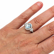 Rare Earth Jewelry Aquamarine Engagement Ring on Finger Oval Halo