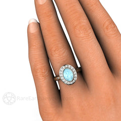 Rare Earth Jewelry Oval Aquamarine Bezel Halo Right Hand Ring on Finger