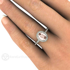 Oval Morganite Halo Ring on Finger Rare Earth Jewelry