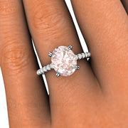 Rare Earth Jewelry Pink Morganite Engagement Ring on Finger Oval Cut Solitaire