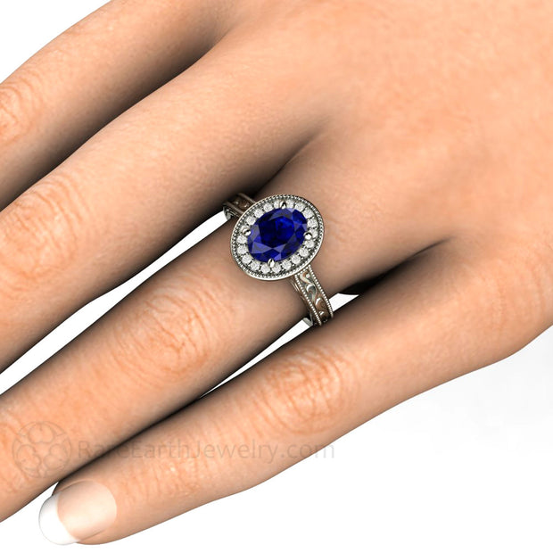 Oval Royal Blue Sapphire Solitaire Engagement Ring on Finger Rare Earth Jewelry