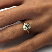 Natural Green Amethyst Engagement ring on the Finger in Rose Gold