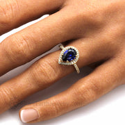 Pear Cut Blue Sapphire Ring with Pave Set Diamonds in Yellow Gold Hand Photo
