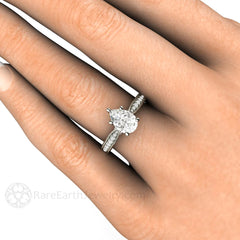 Pear Moissanite Engagement Ring on Finger Rare Earth Jewelry